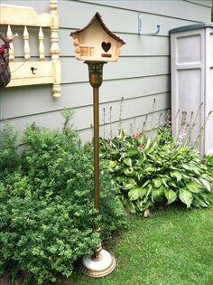 Repurposed floor lamp to make an outside birdhouse decor.