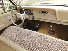 The simple 1973 Wagoneer interior. I love the houndstooth seats. So cool.
