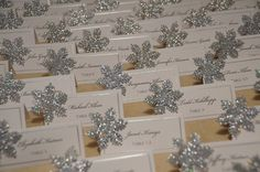 Place cards adorned with glittering snowflakes.Photo Credit: Jessica Lauren Photography