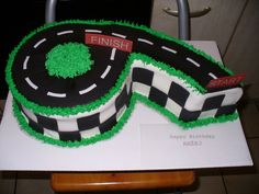 Race Track 6 All fondant with rice paper signs. For the Hot Wheels fan