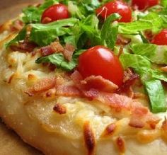 BLT Pizza: There are very few ways to improve on perfect game day food like pizza, but we're willing to bet a generous smattering of crispy bacon is one of them. Prepared crust makes this speedy recipe even faster.