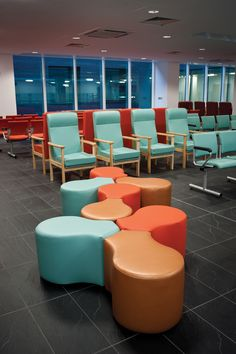 Modern hospital waiting area design at surgery. Featuring bright modular furniture and slate tiles.