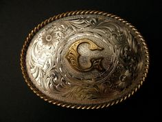"""""""G"""" belt buckle. I'd wear this, if it wasn't too gaudy or flashy."""