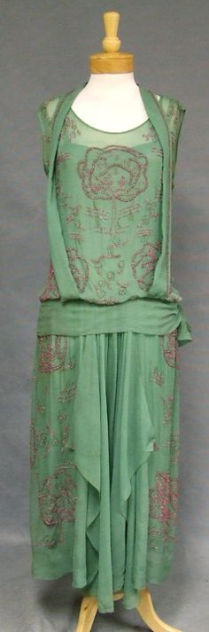 1920s Beaded Silk Evening Gown in a dusky green shade with metallic embroidery and unusual beaded magenta trees. HAND stitched and beaded. Via Vintageous.