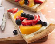 Fruit pizza with sugar cookie crust- during high school volleyball one of my friend's parents used to always make this for us for team dinners- unbelievably delicious and the seasonal fruit tops it off perfectly.