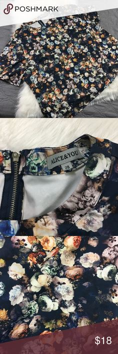ASOS Curve Boxy Scuba Floral Navy Cropped Top Alice & You brand purchased from ASOS. Like new condition only worn once. Not a crop top but a shorter length. Perfect with high waisted pants. U.K. Size 28 which is equivalent to a us 24 or 3x. This fits true to size in my opinion. No trades please ASOS Curve Tops