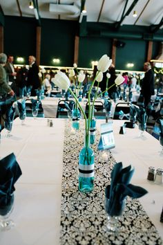 pictures of turquoise table runners at wedding | Joni & Blair's Wedding - The Knot
