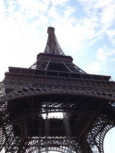 Walking under the Eiffel Tower, Paris. (Photo: WendyJames ~ August 2012)