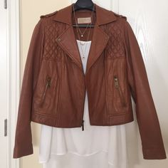 Michael Kors Genuine Leather Jacket This is a Michael Kors brown leather jacket. It has a beautiful quilted leather design on the front. The leather is very soft and the jacket is so comfortable. This is in great condition. Michael Kors Jackets & Coats