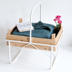 Portable table/tray made from crates used to harvest asparagus in the sixties