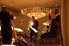 The band setting up for the wedding reception - Drury Lane Oakbrook Terrace IL Photography: Jacqueline Barkley Photography - jacquelinebarkley.com Event Design: Elegant Event Lighting - eleganteventlighting.net Floral Design: Phillip\'s Flowers & Gifts - phillips-flowers.com  Read More: http://www.stylemepretty.com/illinois-weddings/chicago/2012/12/14/chicago-wedding-at-drury-lane-theatre-from-jacqueline-barkley-photography/