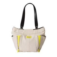 Neon citrus detailing on the Alicia for Demi Miche bags is destined to stop traffic and make you feel happy, happy, happy every time you wear her! Ultra-soft light almond faux leather features decorative zippers on the front, revealing her peek-a-boo bright yellow surprise underneath. Silver hardware and side pockets. *Miche Canada* #miche #michecanada #michefashion #fashion #style #purses #handbags #accessories