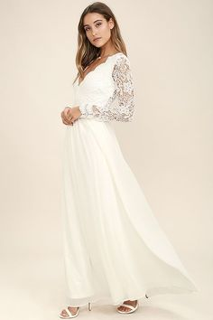 Open your eyes to a world of beautiful possibilities in the Awaken My Love White Long Sleeve Lace Maxi Dress! Crocheted lace elegantly graces the fitted bodice of this stunning dress, with a V-neckline and sheer long sleeves. An open back and banded, fitted waist sit above a romantic full length skirt. Hidden back zipper with clasp.