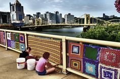 Knitted blankets and other fiberart created by artist communities is used to decorate the Andy...