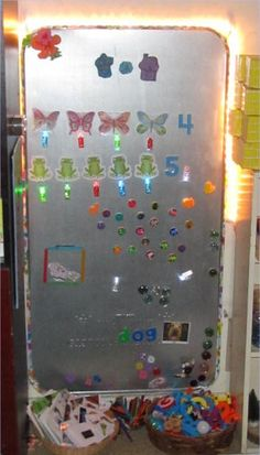DIY Magnet board and DIY magnets.  Guess who's making this soon?  This mama!  What a great idea!