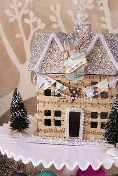 This is EXACTLY what I like in a little house.....glitter and sheet music, two of my favorite things!!!
