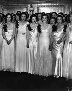 Satin and pearls were popular choices in 1931. | 14 Delightful Photos Of Vintage Debutante Style