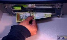 Venezuela currency plunges through key dollar barrier