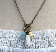 The Let It Go necklace invites you to set down what no longer serves you through the support of citrine, aquamarine, and ice quartz.