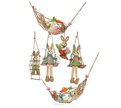 Swinging Bunnies Set of 6 Swinging Bunnies in assorted sizes, shapes, and poses. Includes: 2 laying in hammocks, 1 sitting on a carrot, 1 climbing a ladder, and 2 on swings.Hammocks: