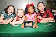 Adorable Annie orphans Madi Rae DiPietro, Emily Rosenfeld, Tyrah Skye Odoms and Georgi James proudly show off their new CD.