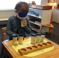 Smelling Bottles or Boxes. Material Description: Pairs of bottles containing various substances with distinct odors, such as spices, herbs and essential oils. Children match the smells together.