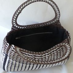 Cant decide if you want brown or black? This purse covers both the bases. The bottom 2/3rds starts off with black, and the top is done in chocolate brown. I designed this one of a kind fashion forward purse using approximately 1,200 pop tabs. The pop tabs in the handles have been sanded for comfort. The flap is made out of recycled leather and adorned with a fleur de lis. The lining features a practical zipper pocket. This purse is definitely an eye catcher.      *** Im happy to ship outside…