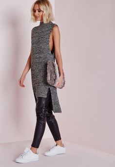 You'll look knit hot in this chunky sleeveless jumper this season. In a dreamy grey tone, this super soft knit is a major trend player. Featuring a drop hem and funnel neck finish, we're styling with a pair of faux leather pants and white p...