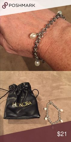 Honora Sterling Teardrop Pearl Bracelet NWT Beautiful Honora Sterling silver and pearl bracelet. 5 teardrop pearls hang daintily from a sterling silver bracelet. Toggle clasp. Fits small to average size wrist. NWT and in original box. Honora Jewelry Bracelets
