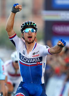 Peter Sagan of Slovakia celebrates victory as he crosses the finish line in the Elite Men's Road Race on day eight of the UCI Road World...