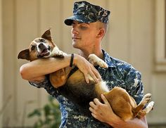 Master-at-Arms Seaman Conrad Schonacher, assigned to Naval Station Pearl Harbor Military Police Working Dog (MWD) unit, carries Malibu, a nine-year-old military police working dog who is nearing her retirement. MWDs are used to apprehend suspects, and to detect explosives and narcotics while searching buildings, ships and submarines.