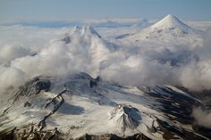 The chain of volcanoes on Unimak, the easternmost Aleutian Island in Alaska, from left to right: Roundtop Mountain, Isanotski, Pogromni and Shishaldin. (Photo: marcofulle) (pinned by haw-creek.com)