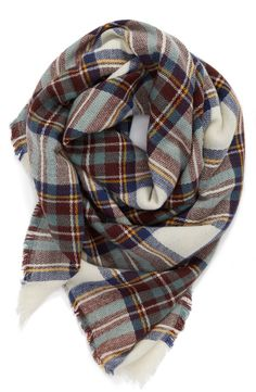 This classic plaid scarf is perfect for staying cozy! Especially loving the colors for fall.