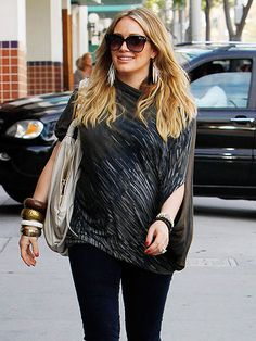 a pregnant hilary duff lookin edgy with fun blouse and accessories.