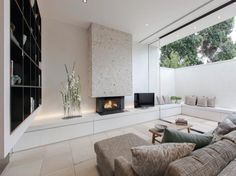 glass wall, enlarging the feel of the space.