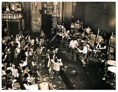 This is a photo of the Allman Brothers Band playing the Fillmore East (patched together from a pan in a video; you can click to enlarge it).