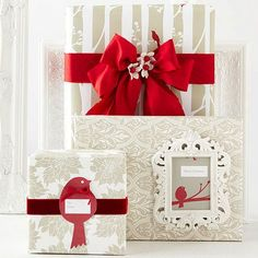 Give holiday packages a festive update with these pretty red birds! http://www.bhg.com/christmas/gift-wrapping/pretty-gift-wraps-and-bows/?socsrc=bhgpin120814cardinalmotifgifts&page=1