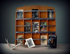 Vintage photo and postcard display rack