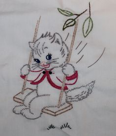 Hand embroidered kitten on a swing.