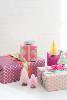 Putting a fun twist on Christmas with bright and colorful gift wrapping that adds festive cheer to the presents.