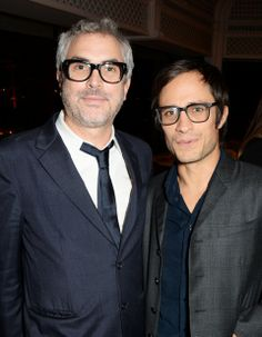 Alfonso Cuaron (L) and Gael Garcia Bernal attend the annual Charles Finch Filmmakers Dinner during the 67th Cannes Film Festival at Hotel du Cap-Eden-Roc on May 16, 2014 in Cap d'Antibes, France. (Photo by David M. Benett/Getty Images for Charles Finch)