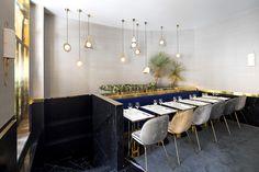 Restaurant in Paris, parisian atmosphere with sofa and Gubi chairs, interior design by Rodolphe Parente and Benjamin Liatoud