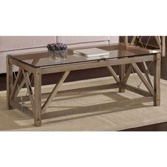 @Overstock - This elegant modern coffee table is constructed from solid wood, and its durable top is made from tempered glass for extra durability. Steel hooks and brackets add an industrial touch, giving this unique table a reclaimed look and trendy vibe.http://www.overstock.com/Home-Garden/Cable-Coffee-Table/6050947/product.html?CID=214117 $184.99