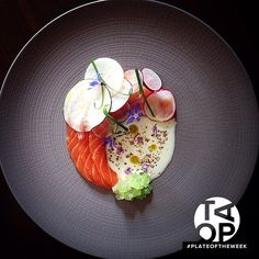 #PlateOfTheWeek Salmon, Radish, Cucumbers, and Garlic Buttermilk by @chefdanielwatkins -- Get the recipe now on htttp://theartofplating.com (link in profile) #TheArtOfPlating