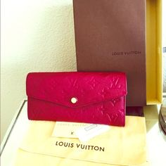 Louis Vuitton Leather Curieuse Wallet Embossed Authentic Pre-Owned -(EUC)--- Louis Vuitton Leather Envelope Style Sarah Wallet - Embossed Monogram in Aurore(Burgundy/Purple)-color Currently available at Louis Vuitton for $920 Louis Vuitton Bags Wallets
