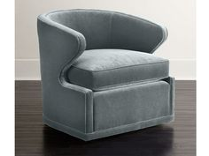 7 Stylish Velvet Pieces to Incorporate into Your Home: Swivel chair from Neiman Marcus.
