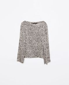 ZARA | Printed top in black and cream | 67% cupro, 33% viscose | £29.95  Note: Cupro is related to cotton.