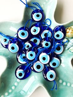 A personal favourite from my Etsy shop https://www.etsy.com/listing/513006786/100-pcs-blue-evil-eye-beads-evil-eye Evil Eye is associated with the eyes and looking from these eyes throughout the history. According to evil eye superstition, negative thoughts and glares comes out of eyes. To protect from evil eyes, the people carry things like shape of eye which reflect negative thoughts, glares and bad luck. #evileye #evileyemeaning #evileyestore #tinyevileye #weddingfavors #blueevileye