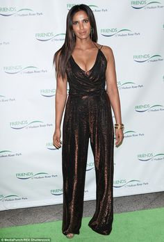 Taking the plunge: Padma Lakshmi showed off her ample assets in a shimmering low-cut jumps...