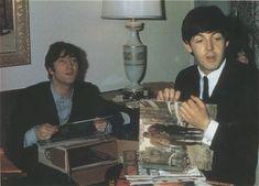 "John Lennon with Paul McCartney holding up a copy of the Dylan album ""The Freewheelin' Bob Dylan""."